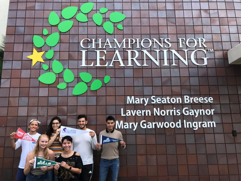 Seniors holding college pennant | Champions For Learning
