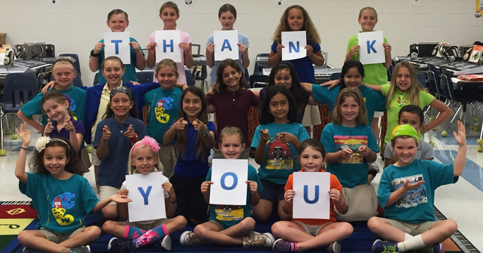 Students in classroom thanking donors for gift - Educators & Schools - Champions For Learning